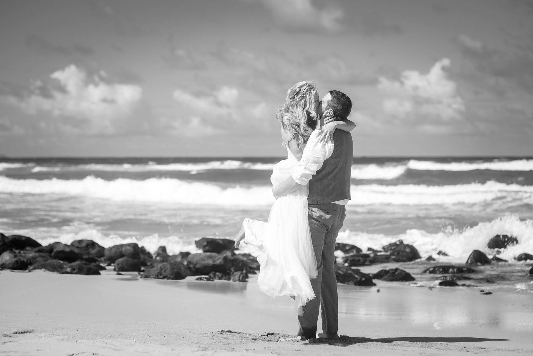 Bride and groom embrace after their wedding on Kauai.