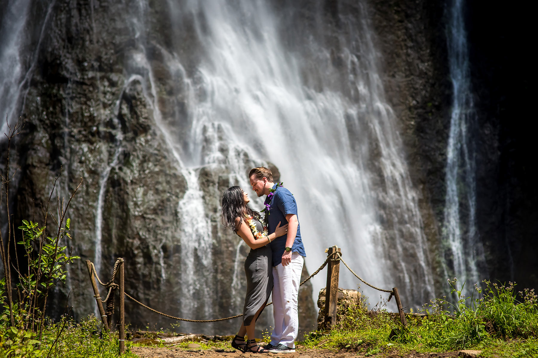 Waterfall, helicopter tour, surprise proposal photographed on Kauai.