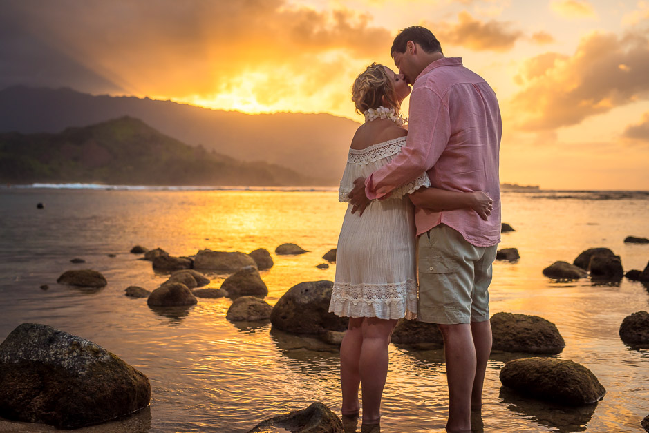 Couple photographed during kiss in the sunset in Kauai.