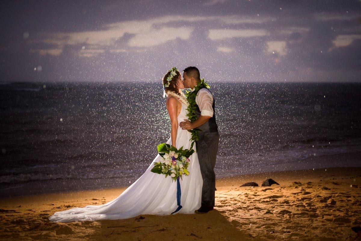 Dramatic wedding shot on the beach.
