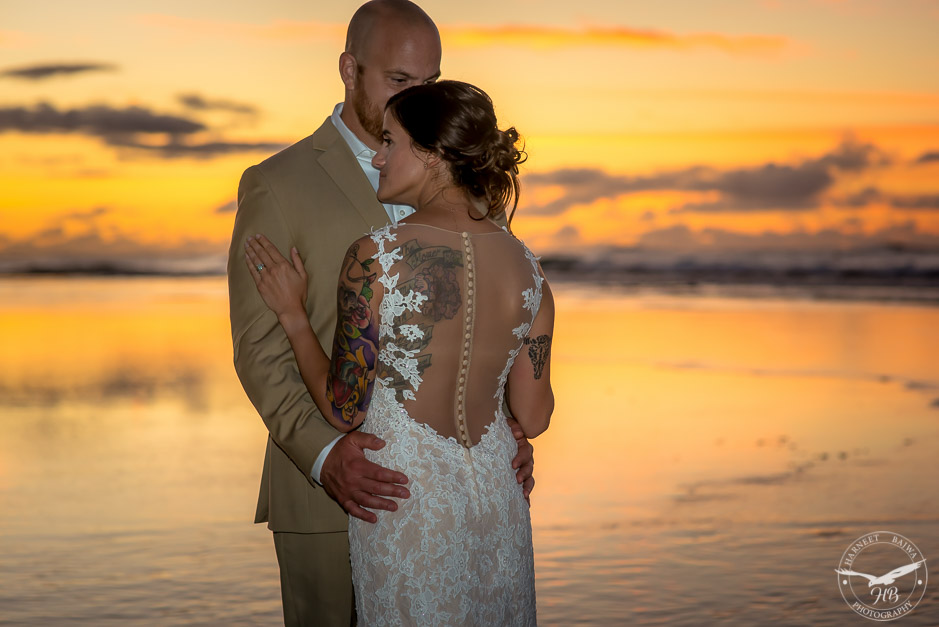 A close up of the bride's fabulous see through dress that shows her beautiful tattoo on her back.