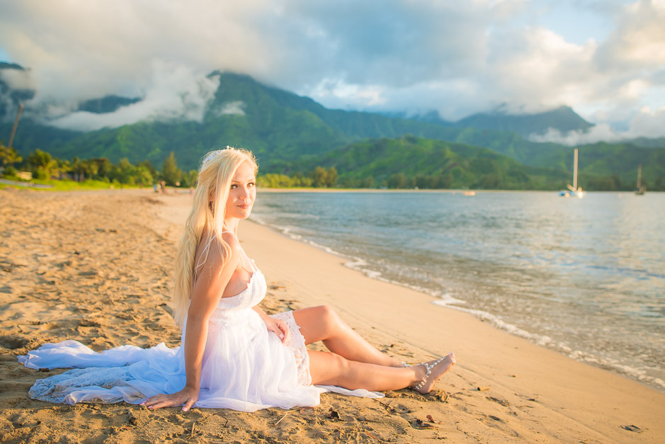 The beautiful bride sitting on the beach relaxing.