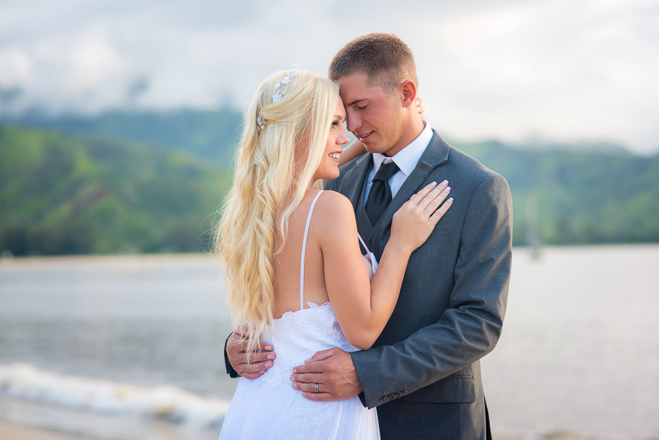 The young husband and wife sharing a romantic moment during the honeymoon photoshoot.