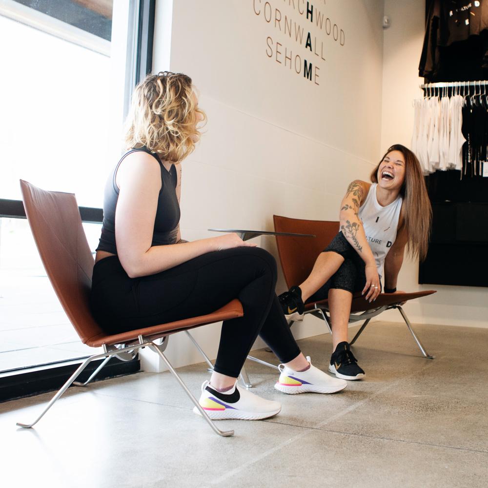 2 people conversing in the studio foyer