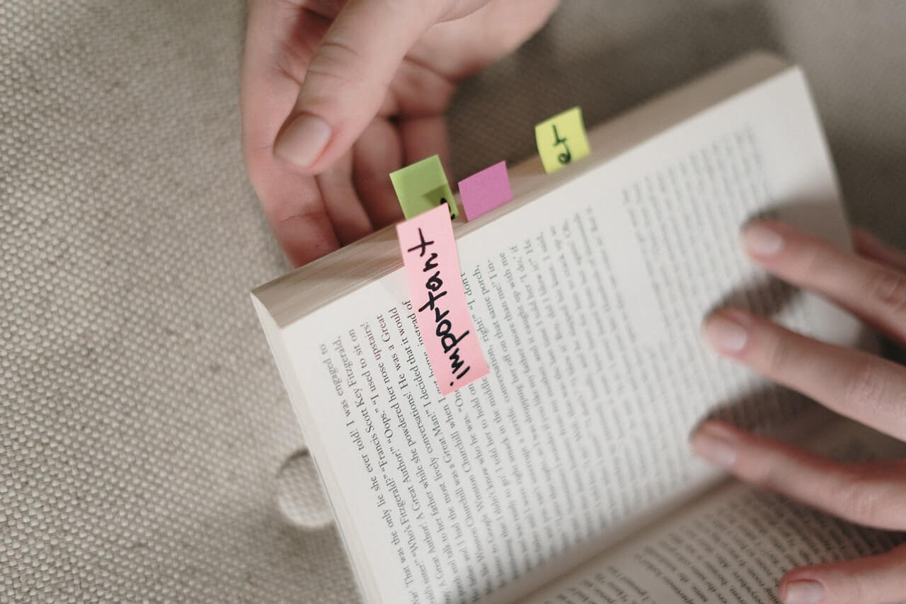 book sticky notes annotations hands fingernails page turning