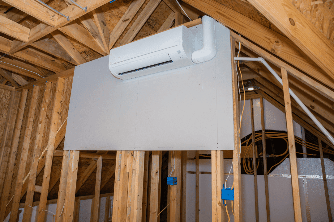 ductless ac unit in unfinished attic room
