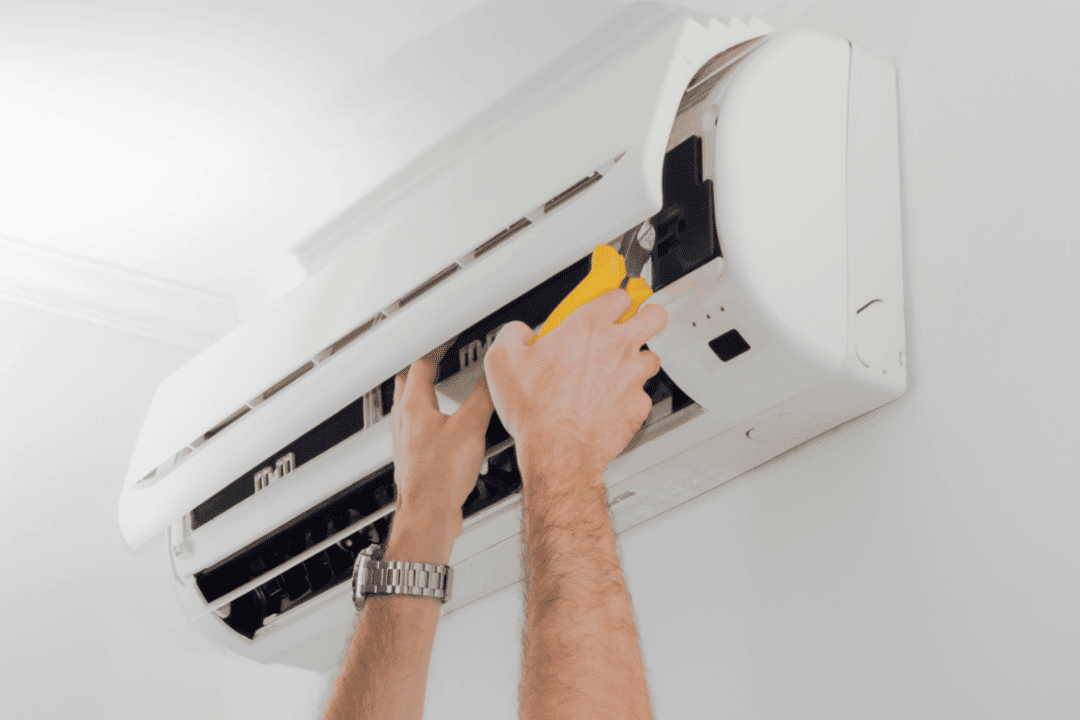 filter change in ductless AC unit hands and watch