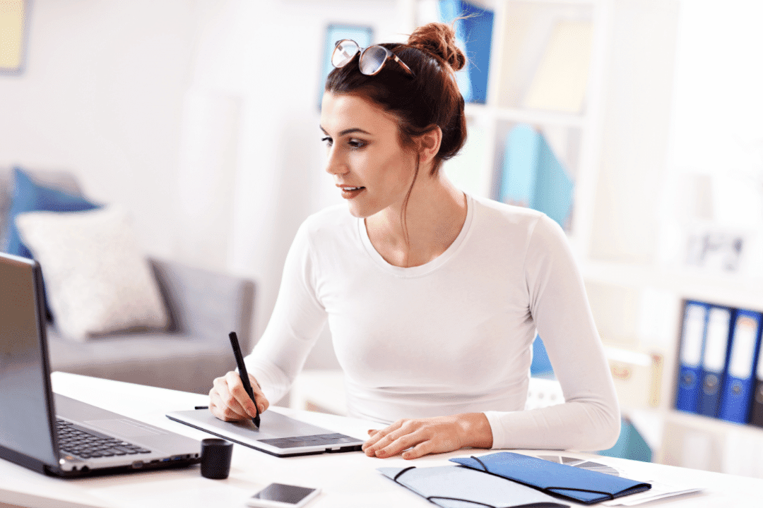 young woman with glasses working in a home office