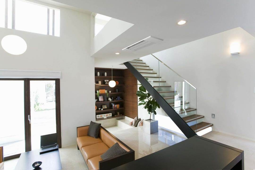 modern home living room area staircase books