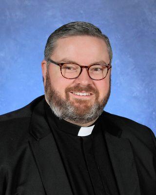 Father Ryan Saunders
