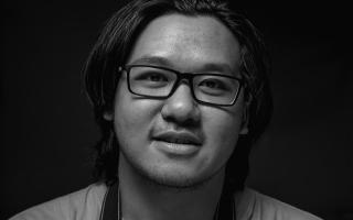 man wearing a black frame glasses