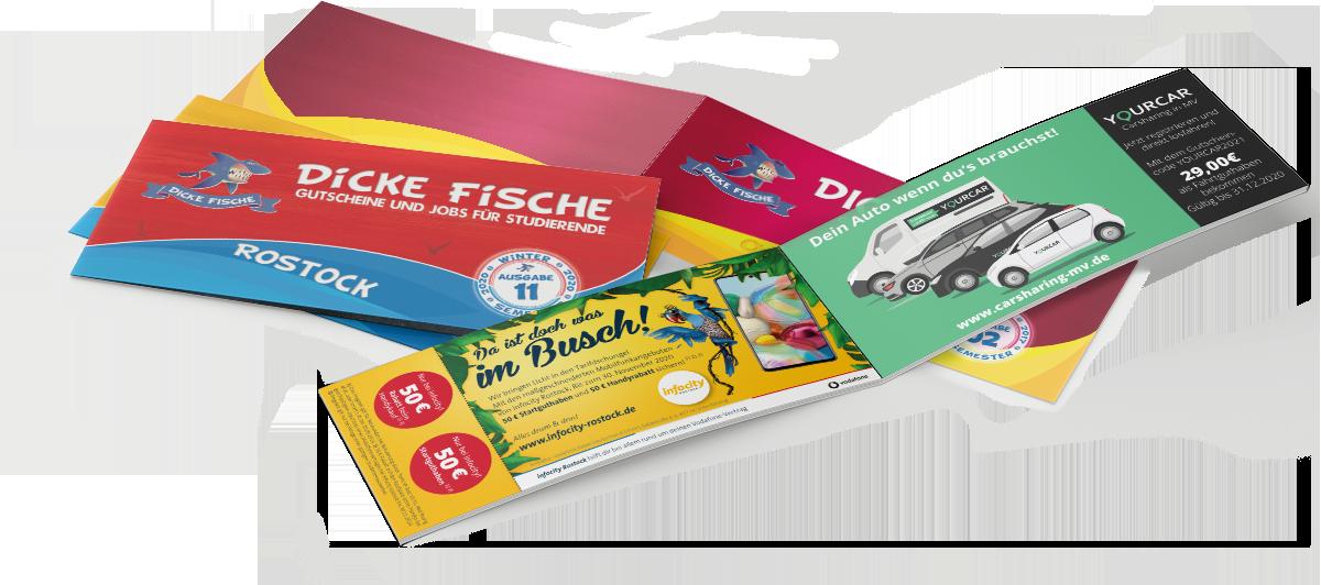Verschiedene Ausgaben der Dicken Fische die Gutschein und Stellenmagazine für Studierende aus Rostock