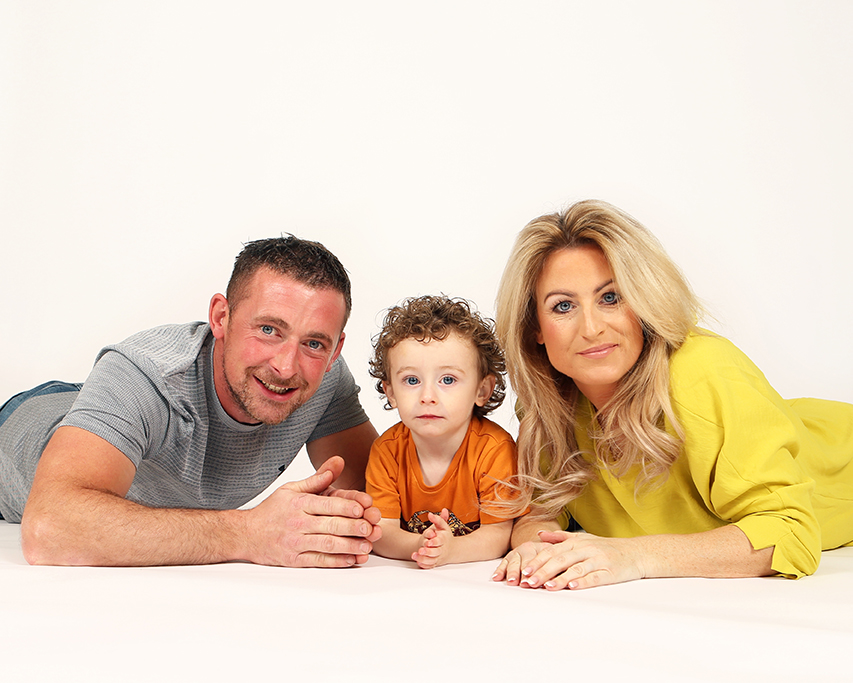 Jenny Callanan Photography Family Portraits, you boy poses with his parents