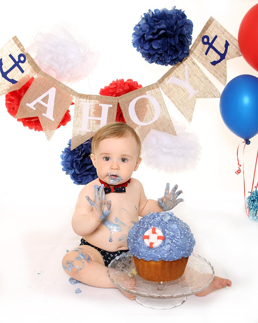 Jenny Callanan Photography Family Portraits, baby boy with his first birthday cake, sailor nautical theme cake smash