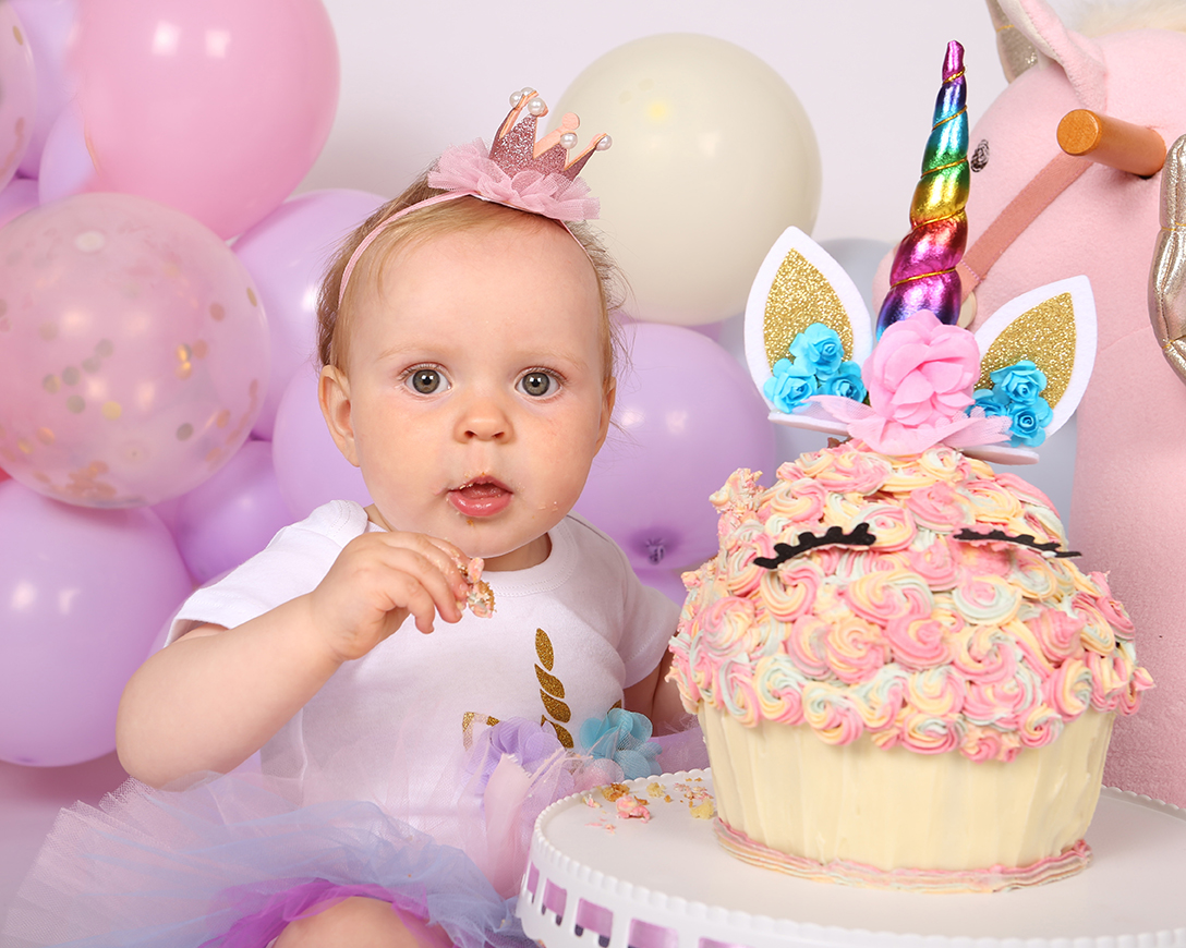 Jenny Callanan Photography Family Portraits, baby girl with her first birthday cake, pink cake smash