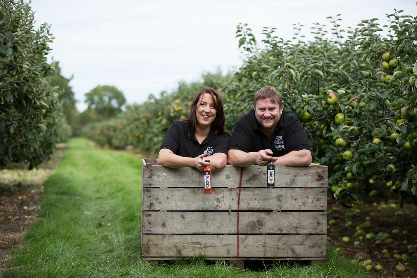 Business Portraits and Headshots by Jenny Callanan Photography, Great Northern Larder founders at apple orchard with their sauces