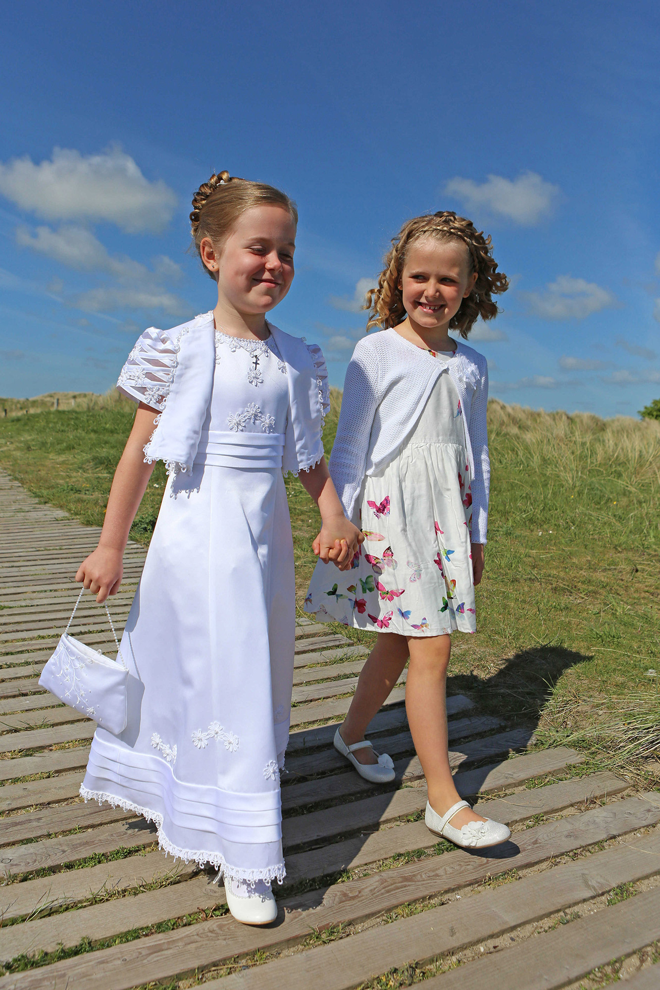 Communion girl with younger sister by Jenny Callanan Photography