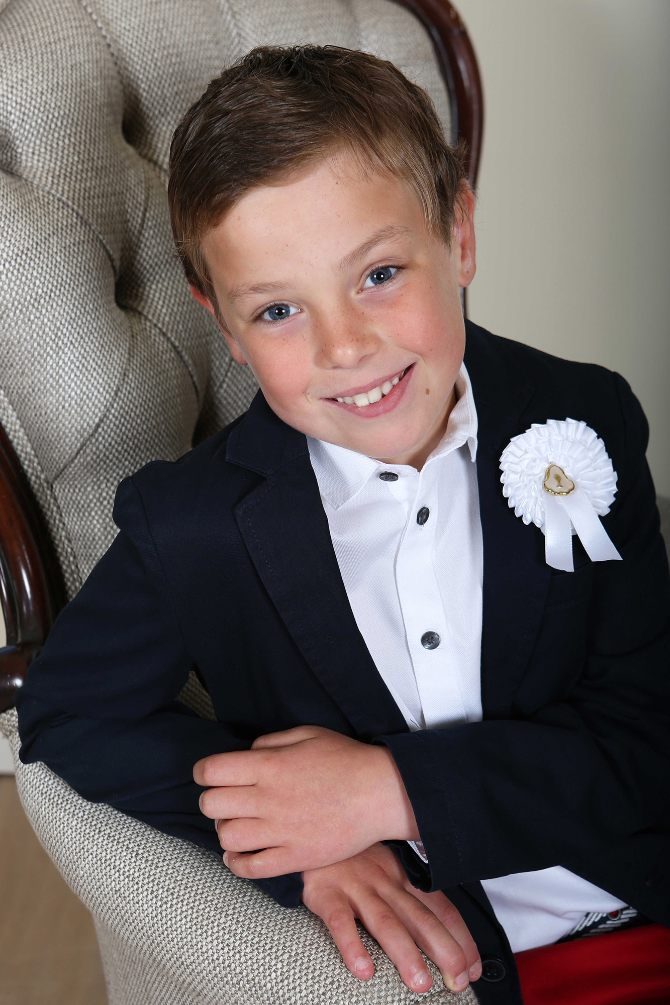 Communion boy by Jenny Callanan Photography