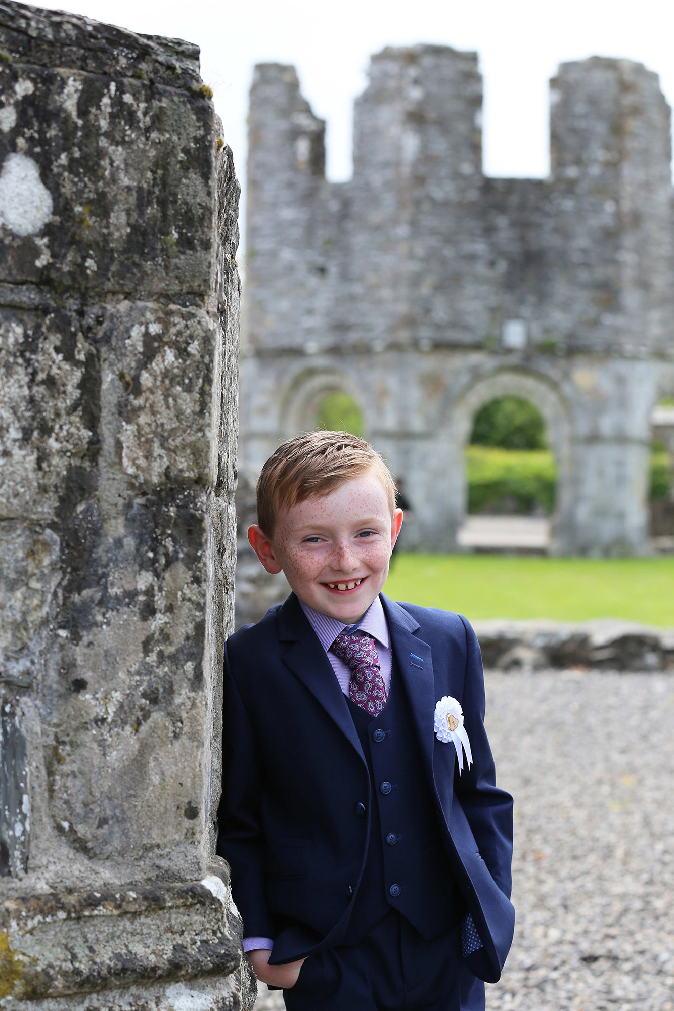 Communion boy at Melifont Abbey by Jenny Callanan Photography