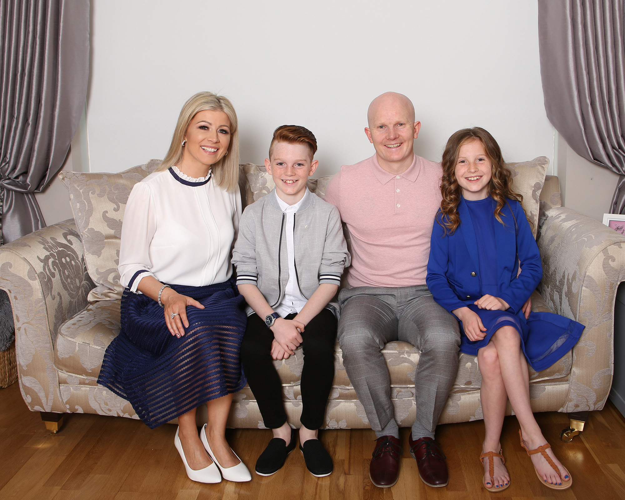Confirmation boy with his family in their sitting room Communion boy by Jenny Callanan Photography