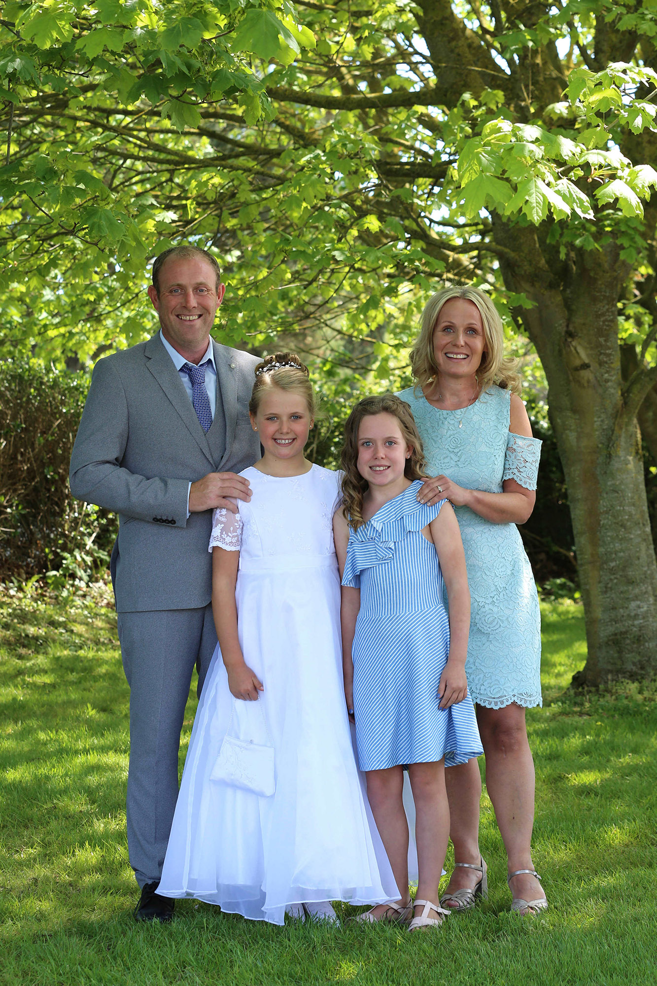 Communion girl with her family by Jenny Callanan Photography