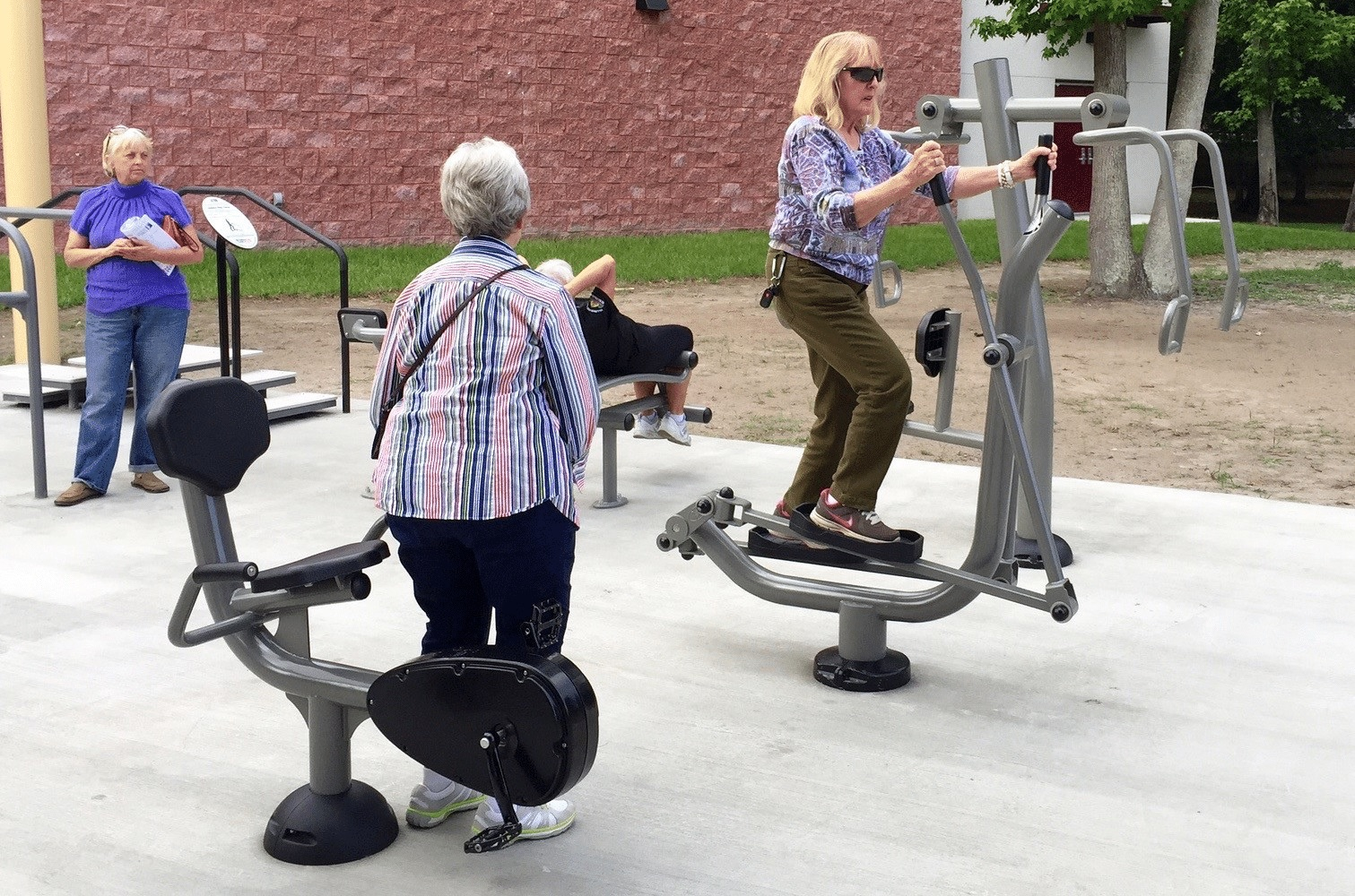seniors working out using fitness equipment