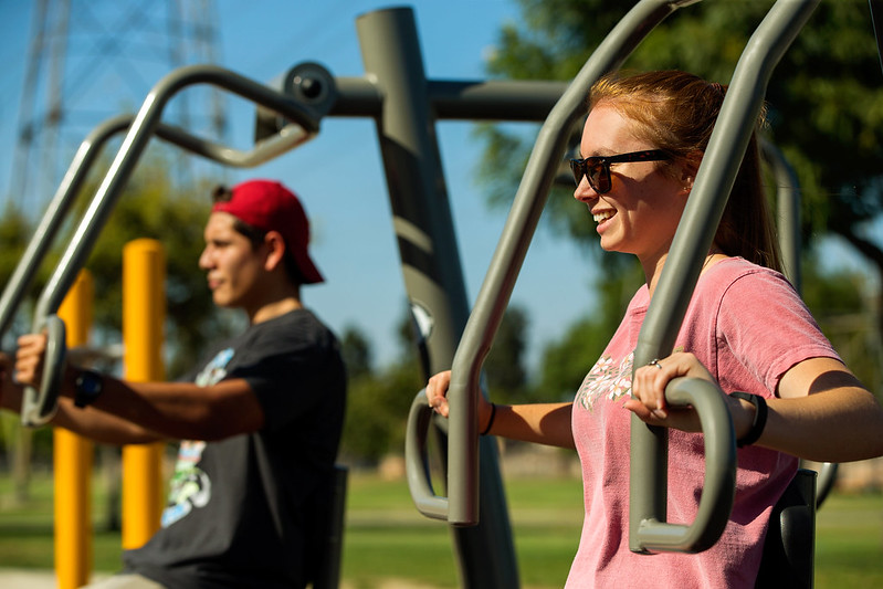 two people working out using fitness equipment