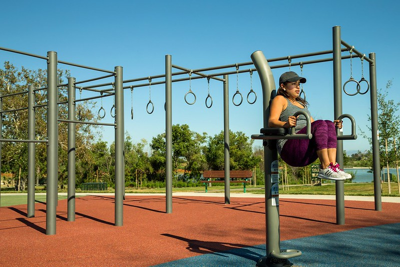 Woman exercising at an outdoor fitness park