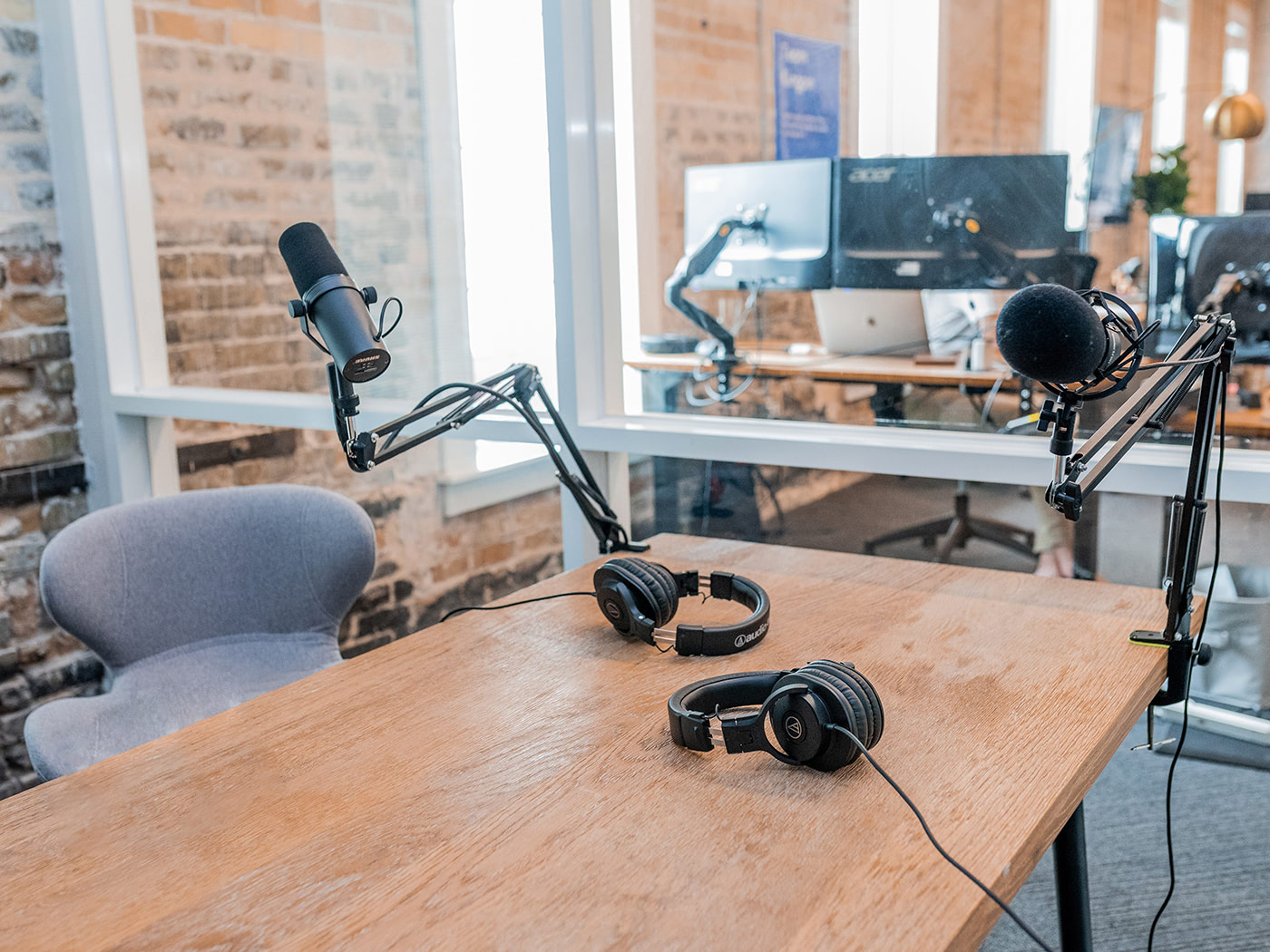 Podcast studio setup with chair table and microphone