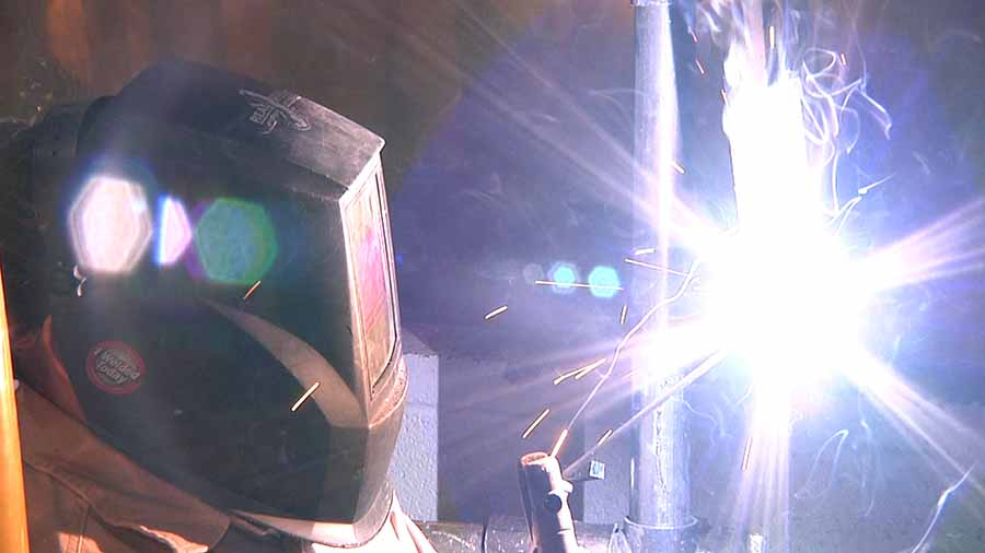 A student welding at school.