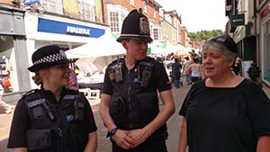 Kim speaking with 2 Bobbies in Winchester, UK.