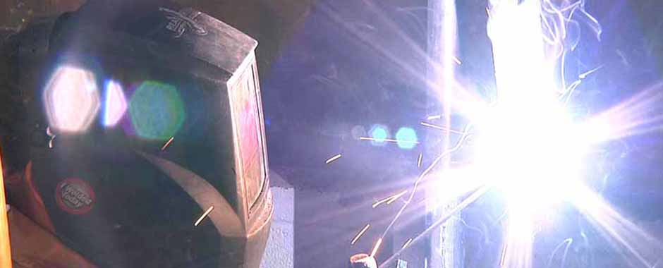 A student in New Mexico practicing  welding.