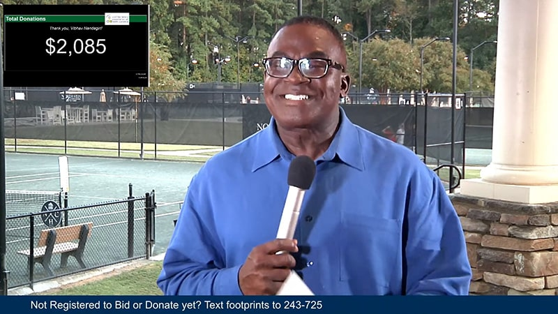 WRAL news reporter hosting a live webcast at a Raleigh tennis club.