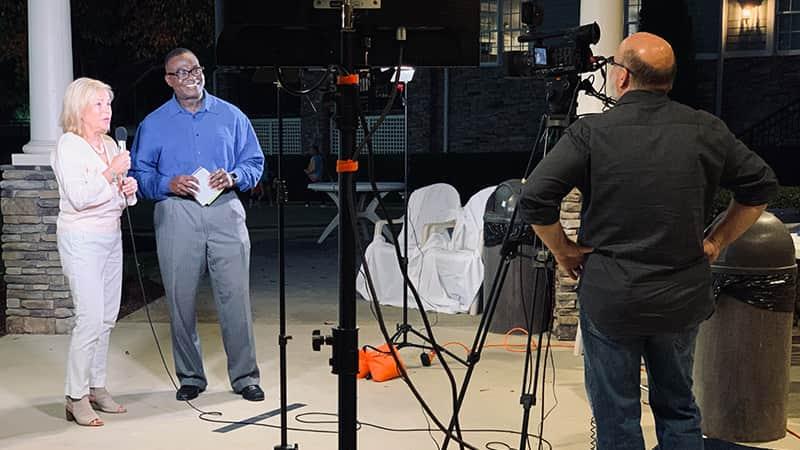 A cameraman shooting video of WRAL new anchor and reporter Ken Smith.