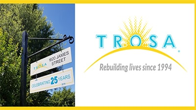 Logo and photo of the street sign for TROSA in Durham, North Carolina.