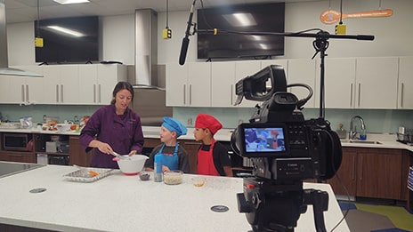 Video shoot of young kids in an instructional kitchen in Raleigh, North Carolina.