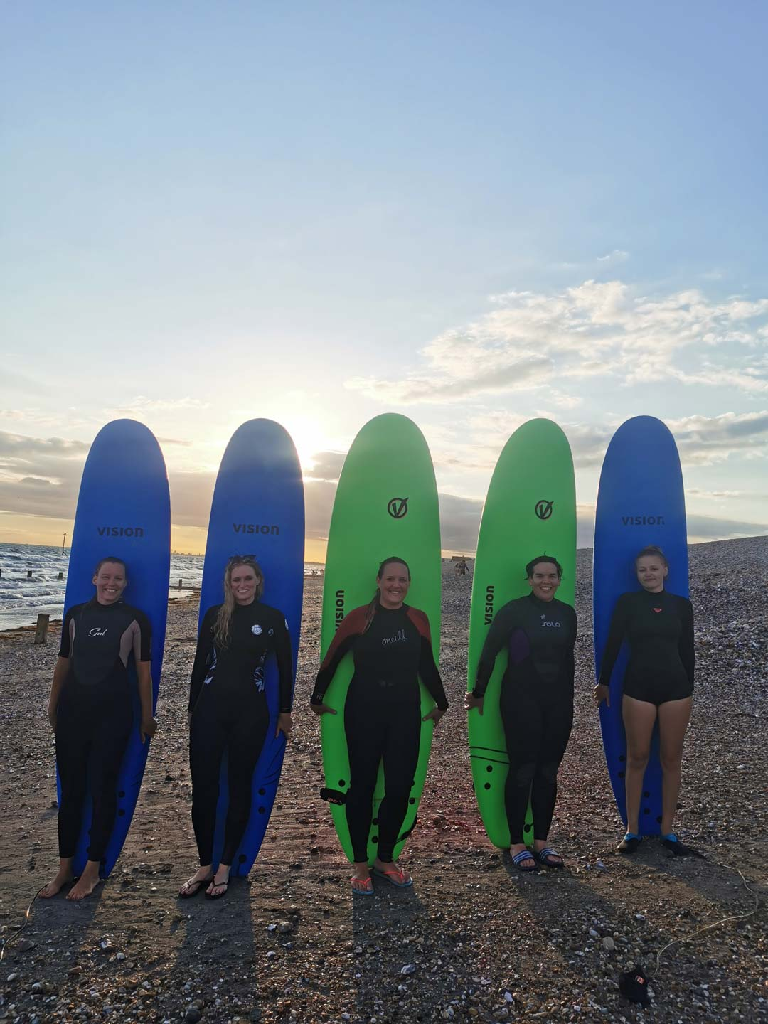 group of surfers with surf boards