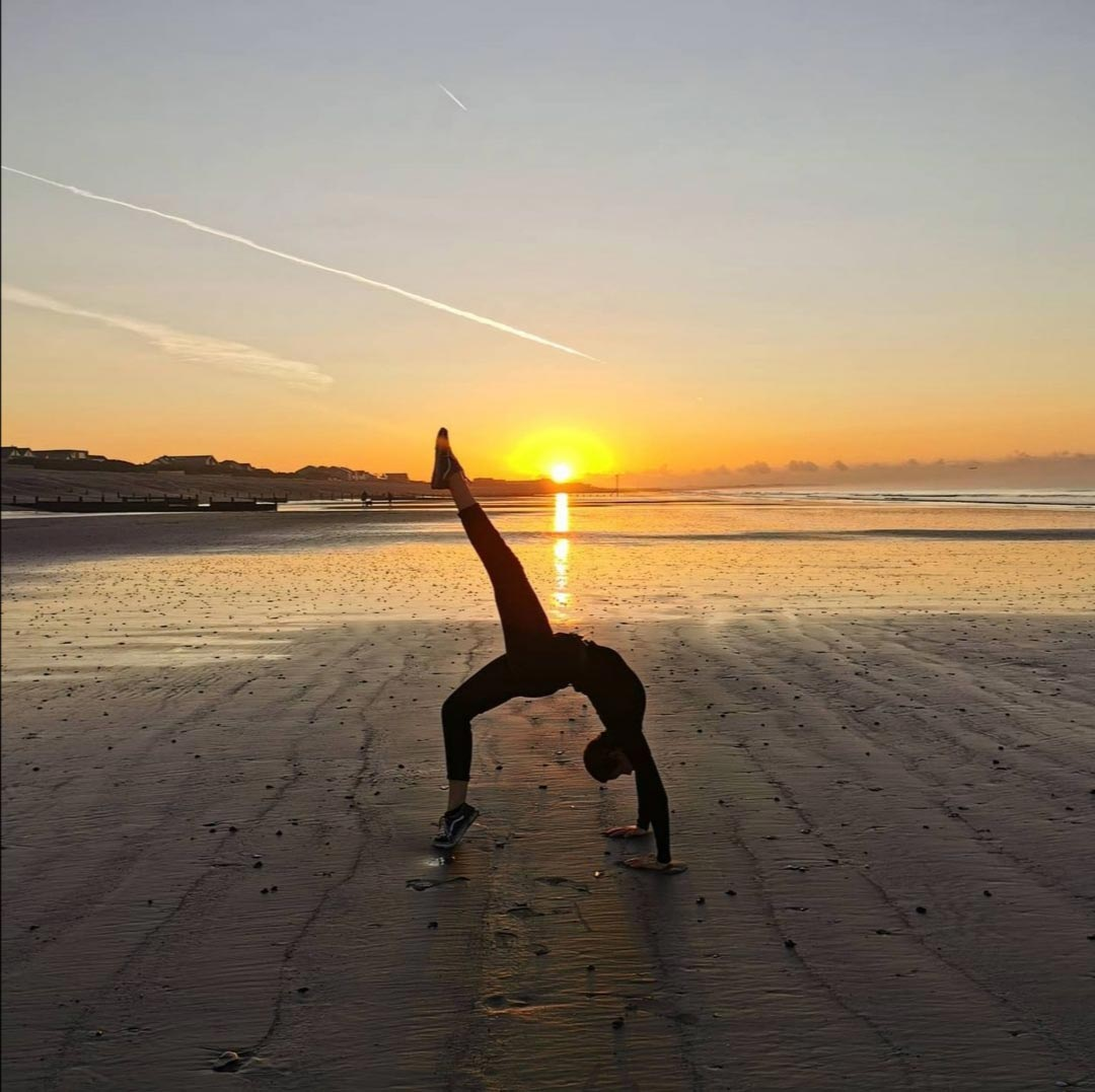 yoga in front of sunrise