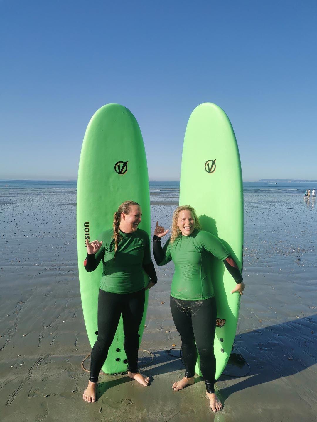 two people with surf boards