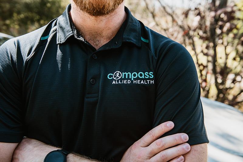 Men wearing compass allied health uniform