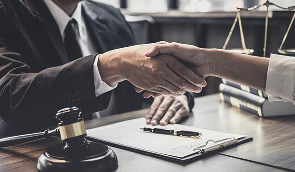 handshake lawyer and client image