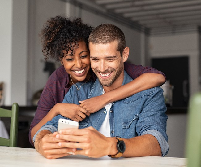a couple looking at a phone together