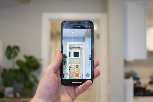 Person taking photos of an open house