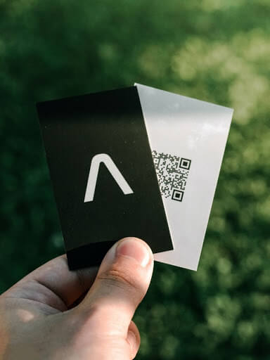 Person handing out business cards at an open house
