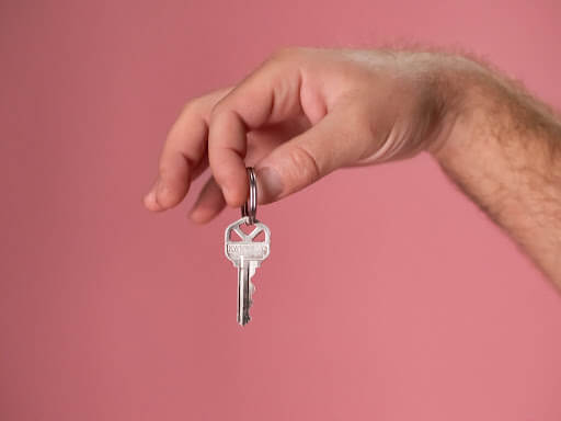 Leasing agent holding keys to new apartment