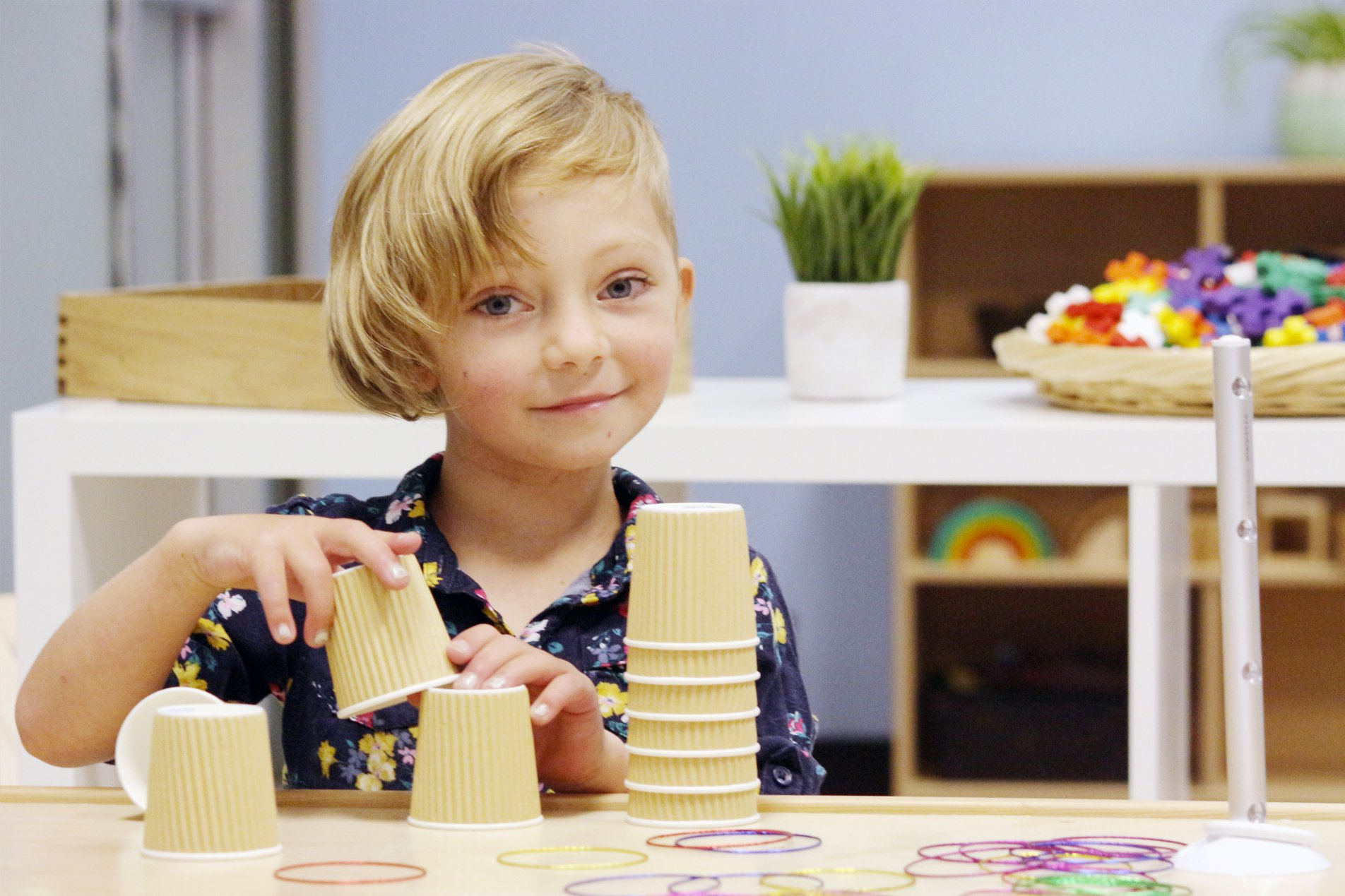 child playing with stacking cups