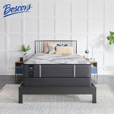 Photo of a neat bedroom with a new, bare mattress