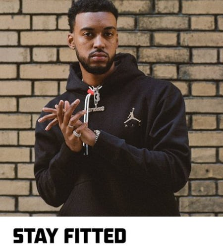 """Young man in a black Air Jordan hoodie with the caption """"Stay Fitted"""""""