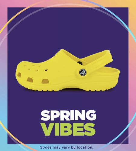 Yellow Crocs with Spring Vibes written below