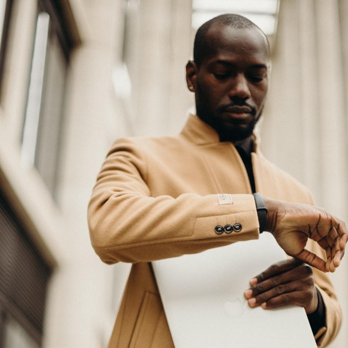 Businessperson looking at wrist watch